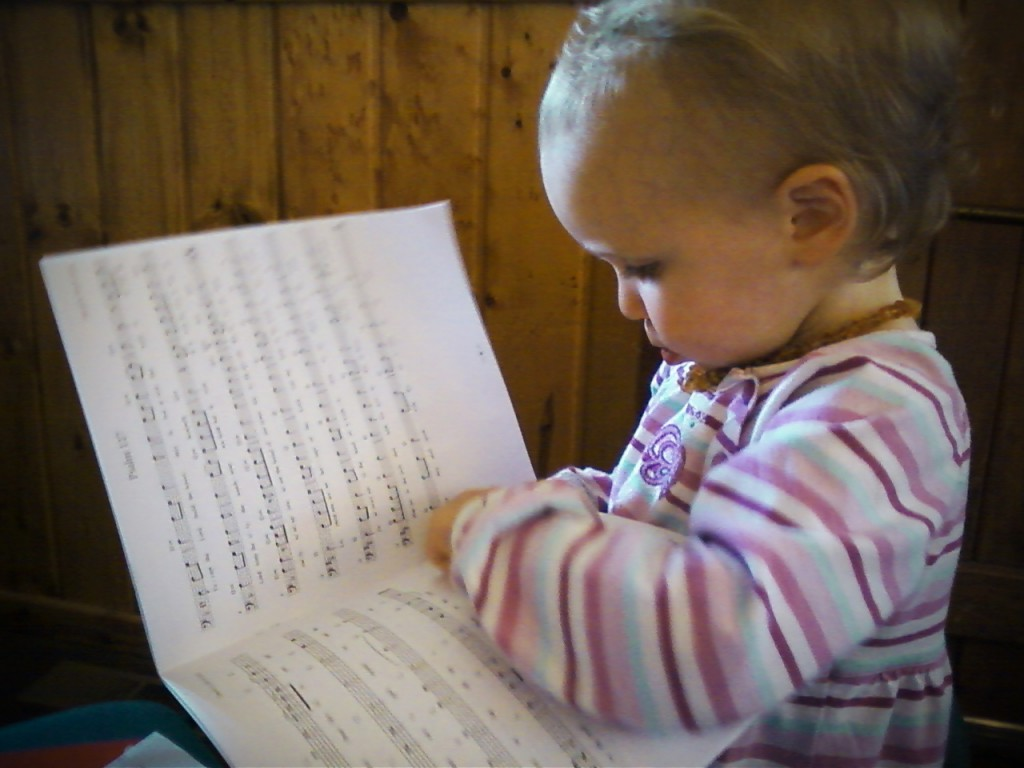 Child studying scripture music